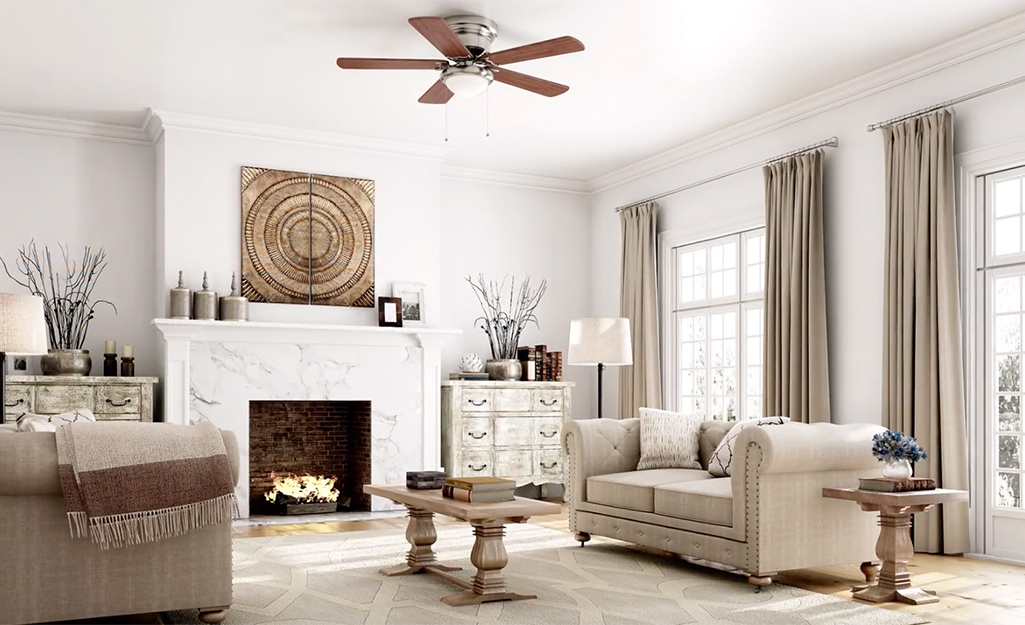 A wood ceiling fan in a white and neutral color living room.