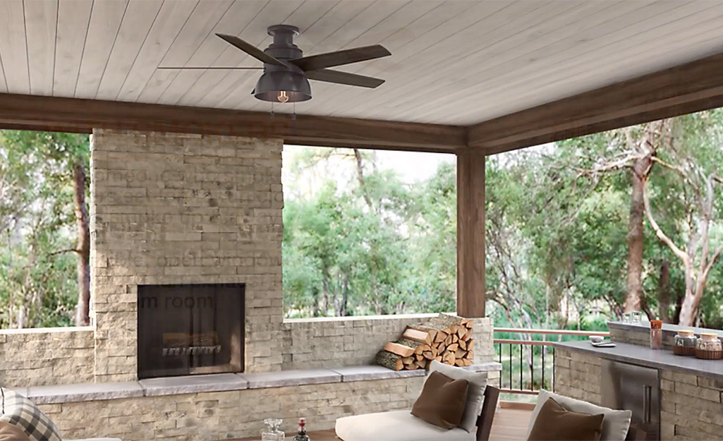 A ceiling fan in a screened porch with high ceilings.
