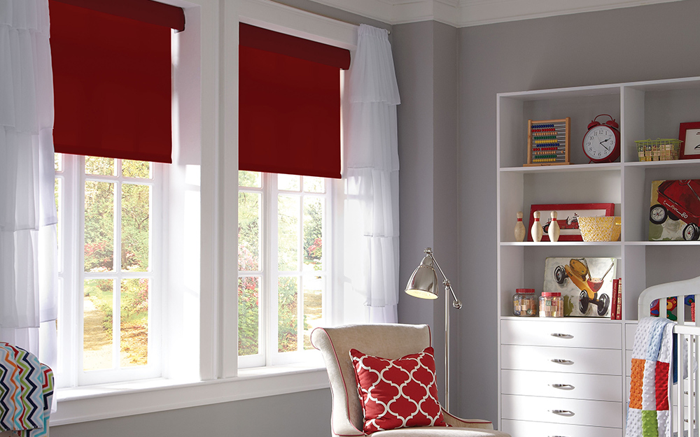 windows with red motorized shades