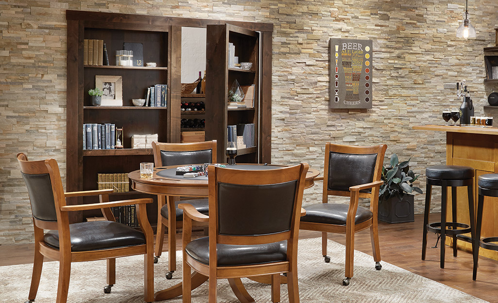 Bookcase doors in a dining area open slightly to show the closet they conceal.