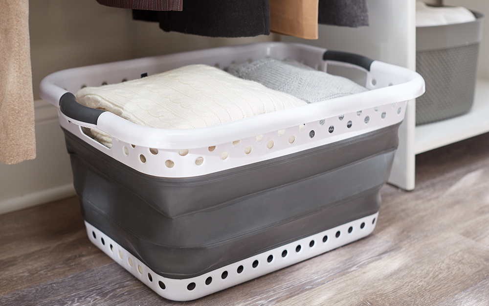 a storage bin with miscellaneous clothes inside