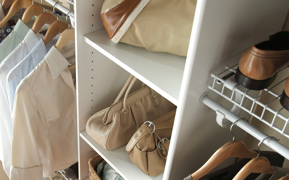 a close up of shoes and other wardrobe items inside a closet
