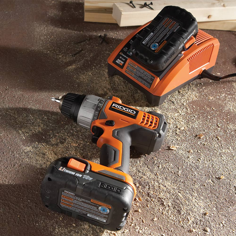 A drill with a cordless battery and a charger.
