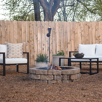 A modern outdoor seating area in front of fire pit.