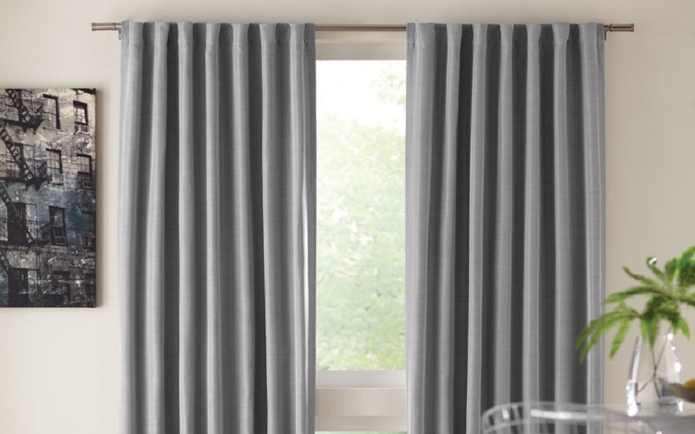 Panel curtains hanging on a window