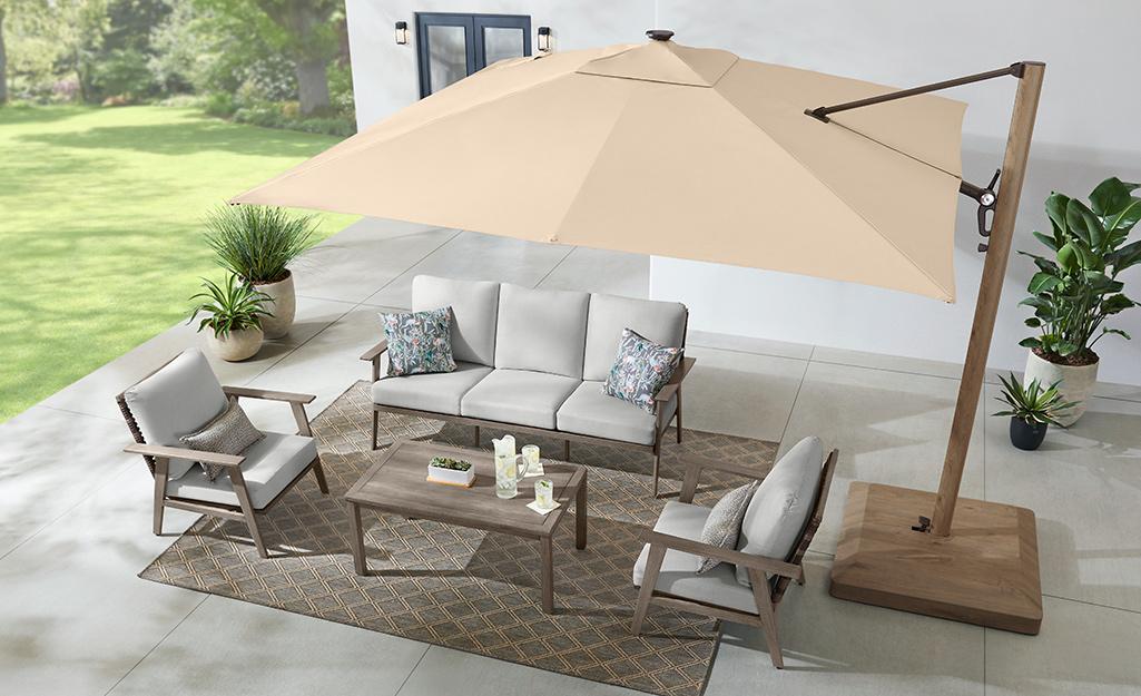 A cantilever umbrella shades outdoor patio furniture.