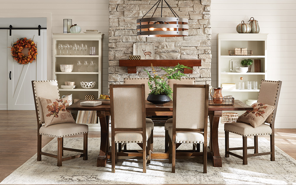 dining room with wall storage and dining table with built-in storage