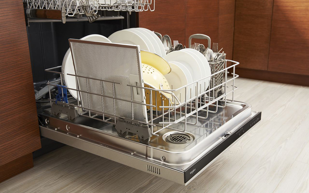 An open spacious dishwasher with a stainless steel interior