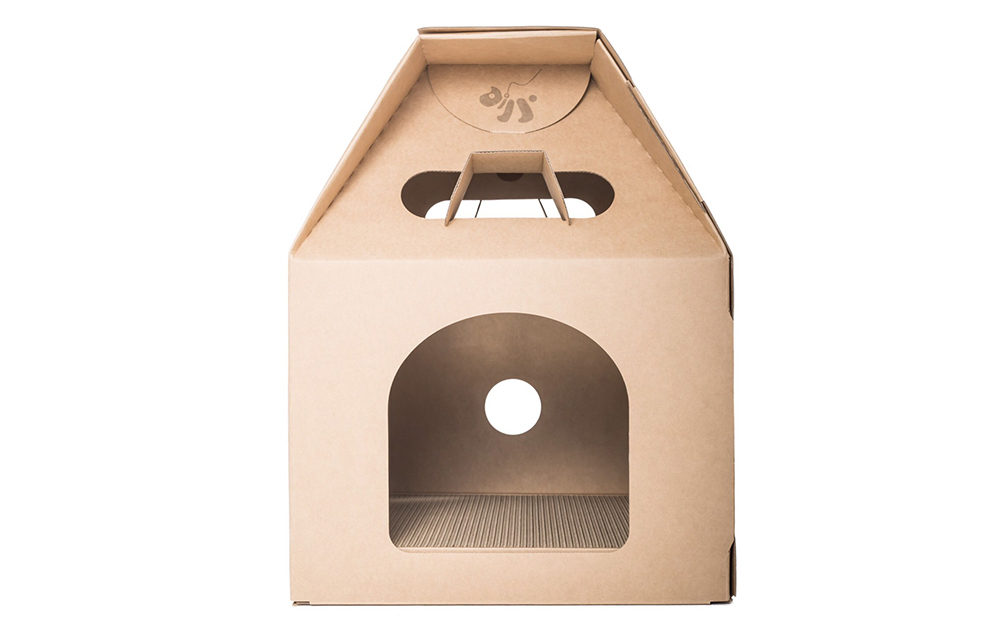 A DIY cardboard cat house with a large entrance.