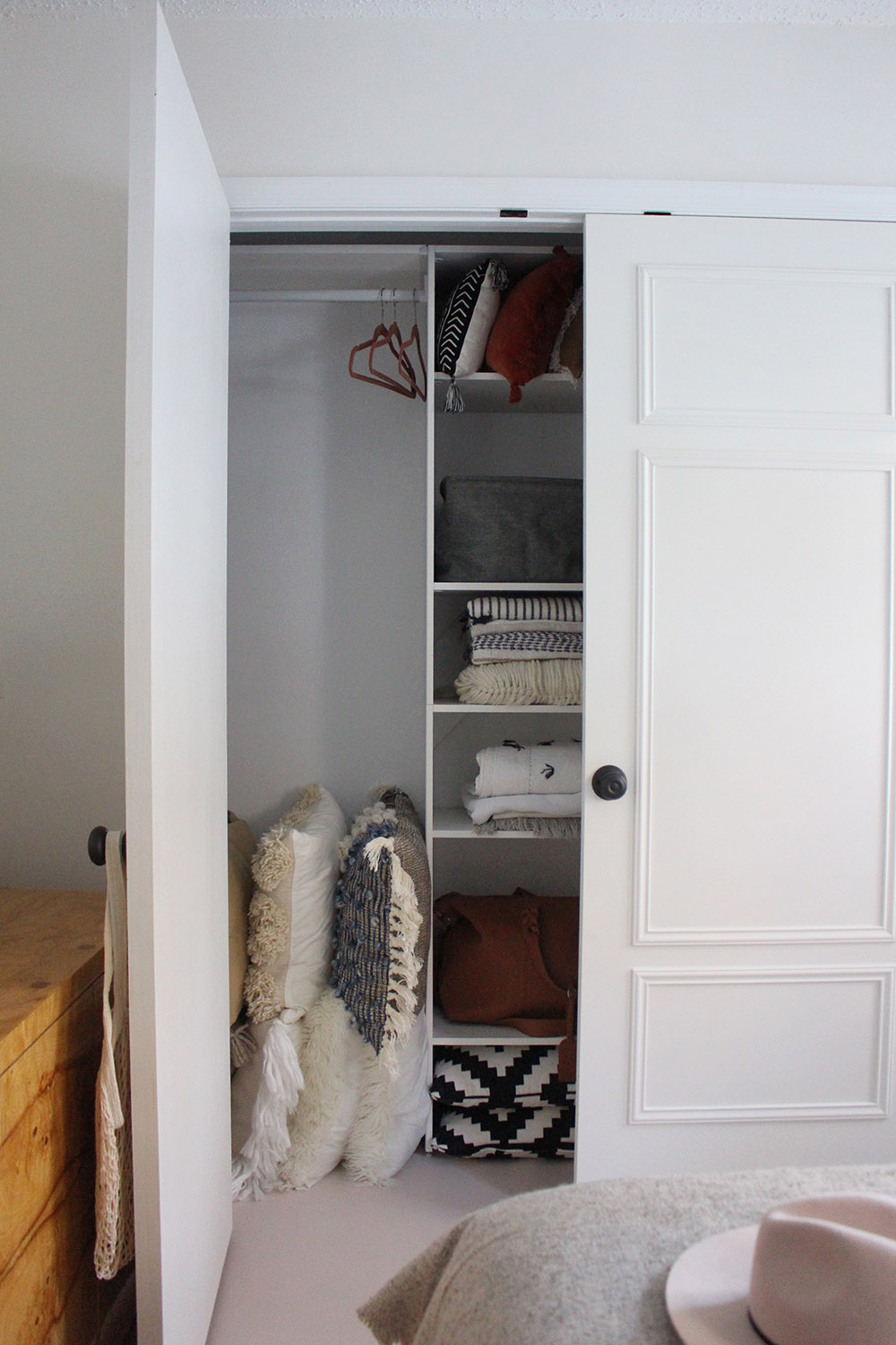The other closet door open with an area for hanging clothes.