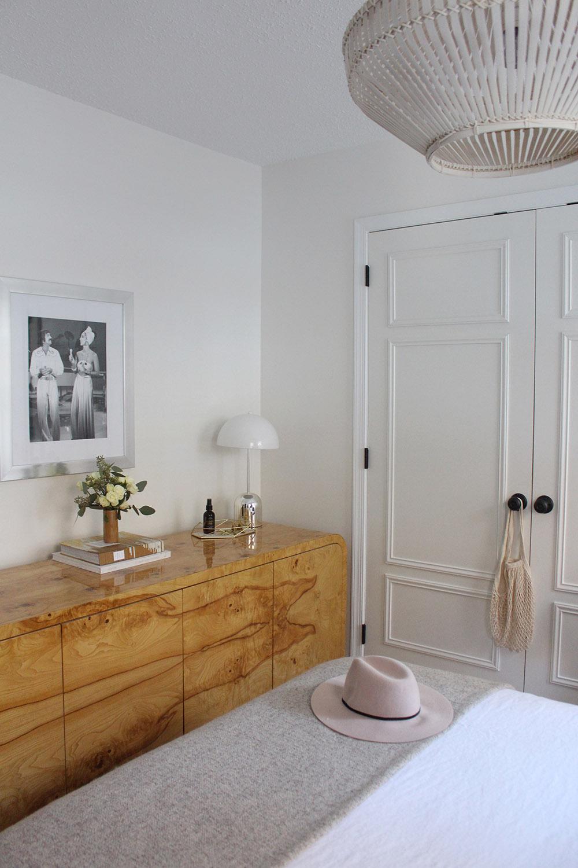 A bedroom with updated DIY closet doors.