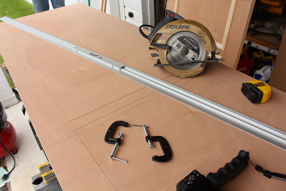 Various items needed to build DIY closet doors such as a saw.