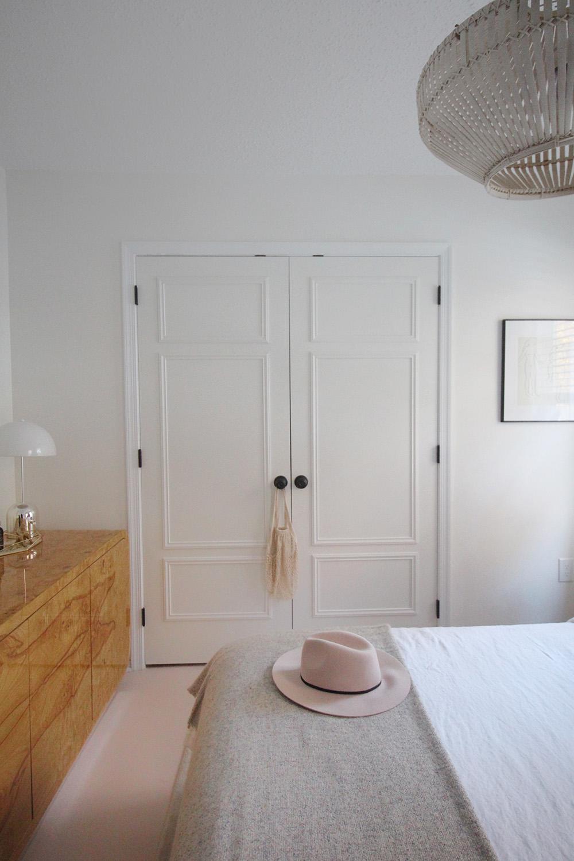 A closet with new DIY closet doors that open.