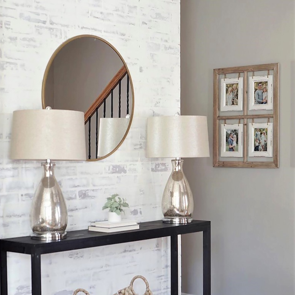 An entryway with a DIY faux whitewashed brick accent wall.