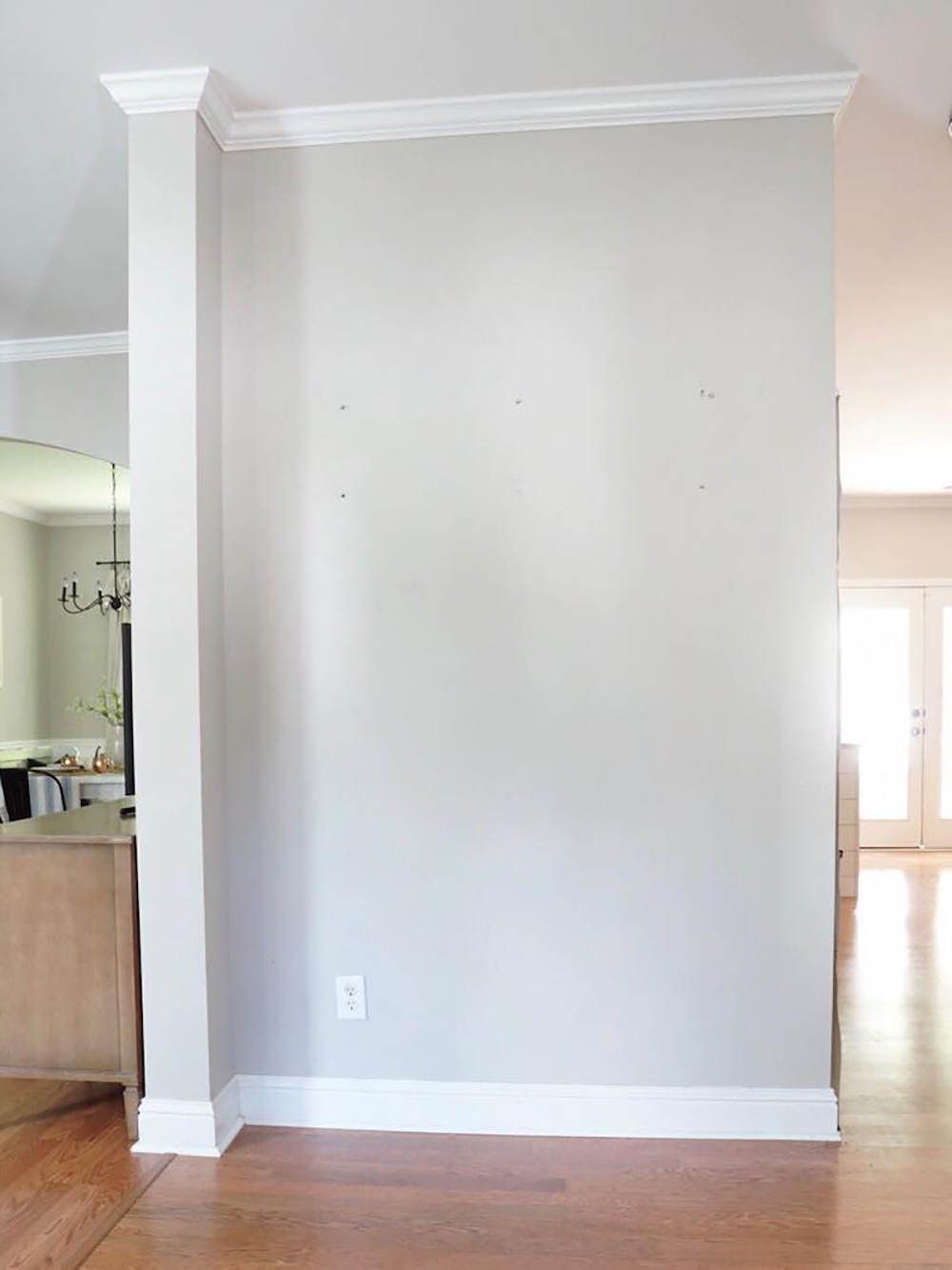 An entryway with a gray wall and no decor.