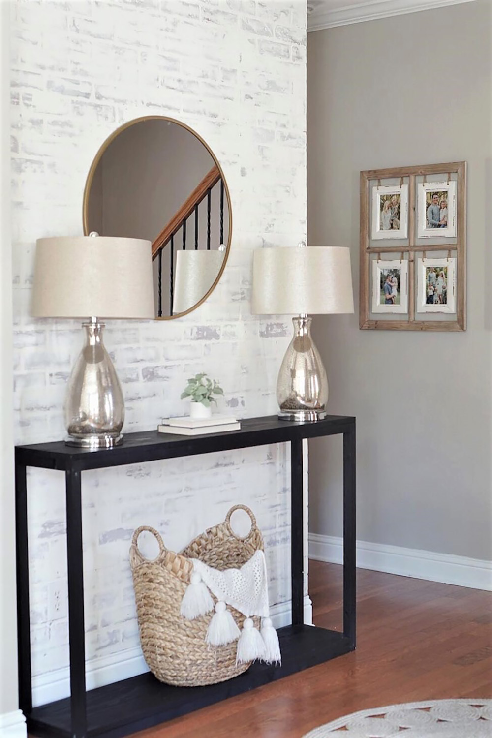 An entryway with a faux whitewashed brick accent wall and decor.