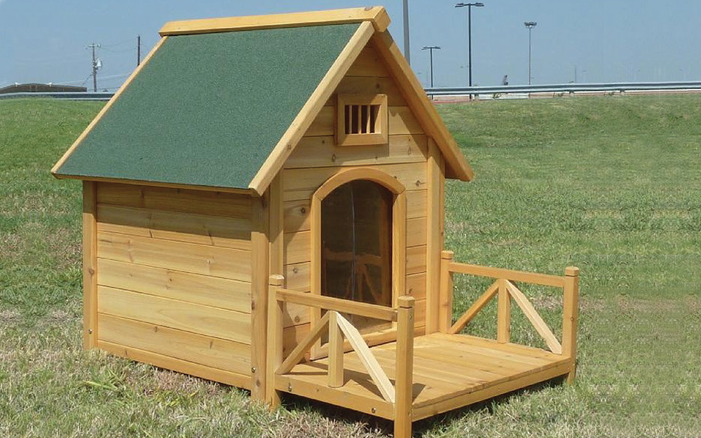A dog house featuring a front porch.
