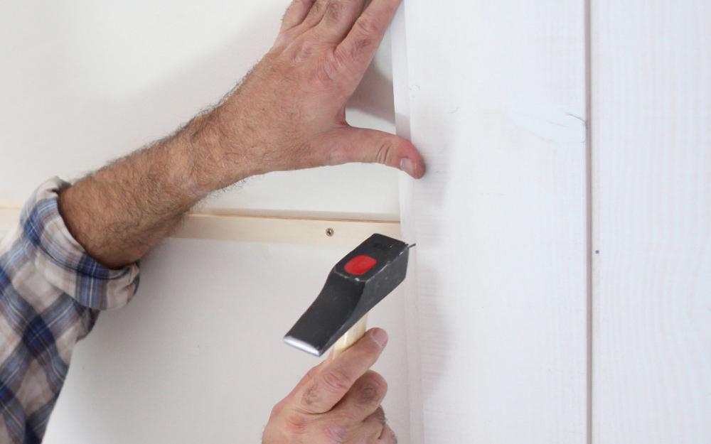 Person installs the top rail.