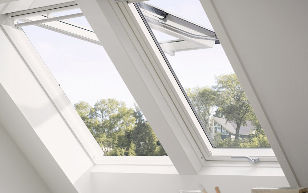 An awning style egress window swings open from the top.