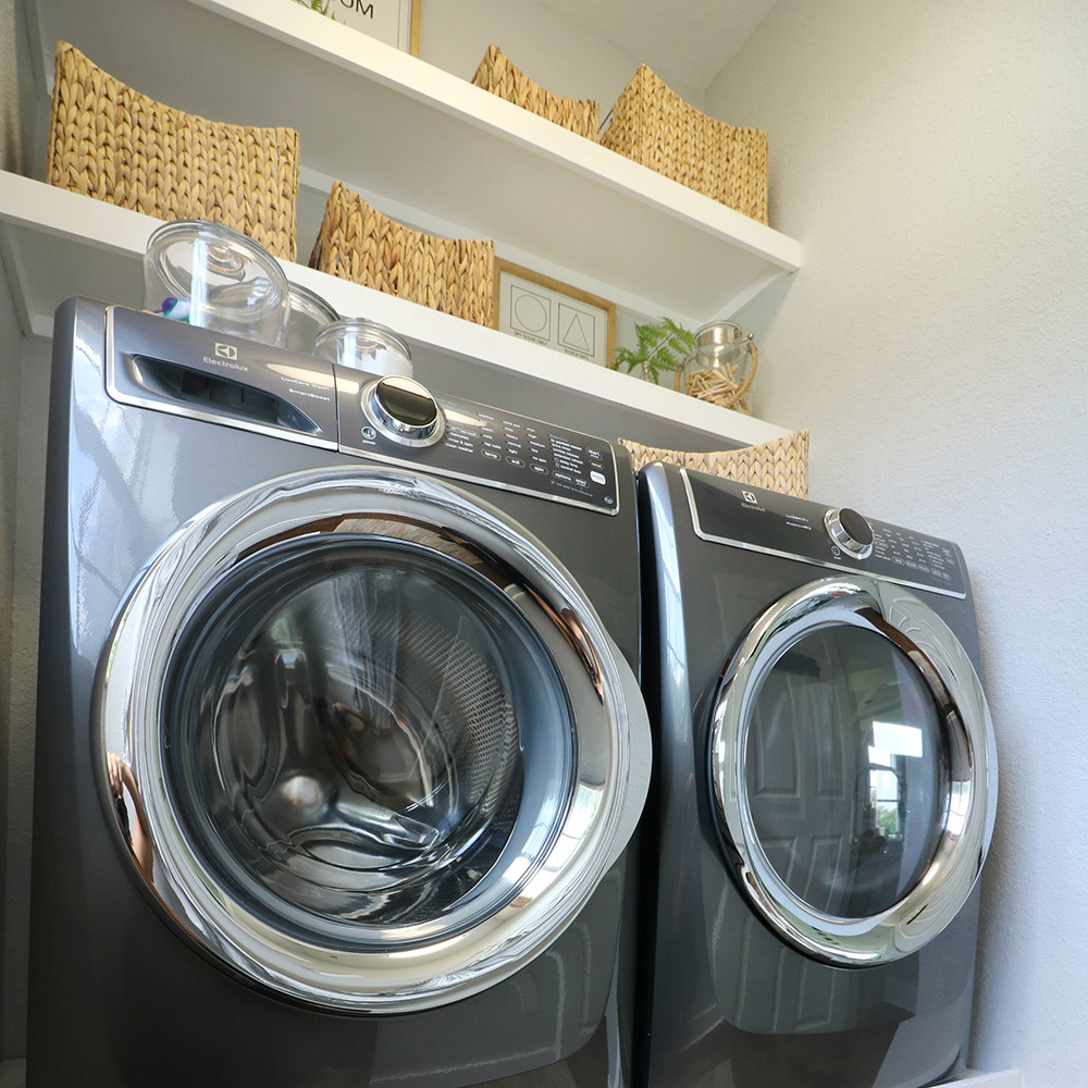 A laundry room with a titanium front load washer and dryer.