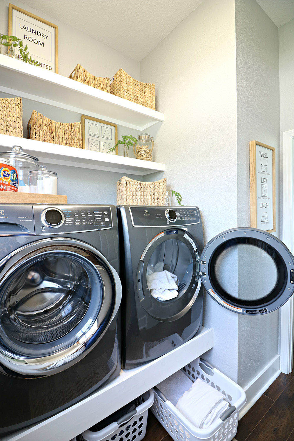 A laundry room with a titanium Electrolux Smart Boost Technology washer and dryer.