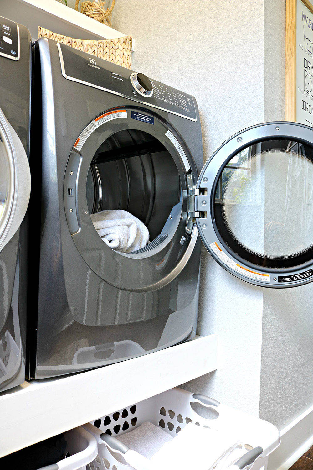 An Electrolux Smart Boost Technology dryer with the door open.