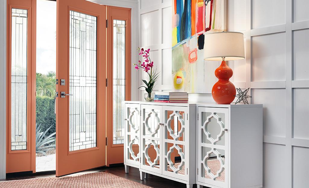Mirrored door credenza placed near front door.