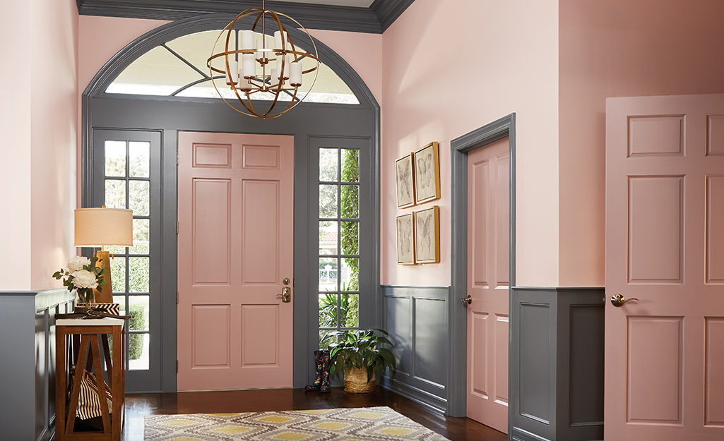 Entryway painted pink and gray.