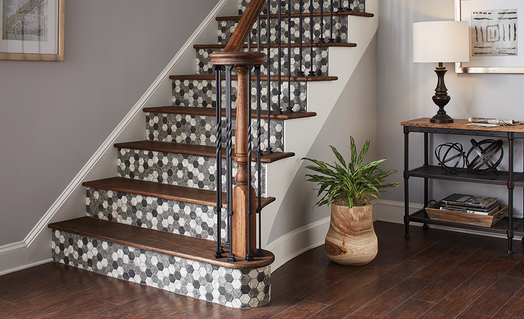 Staircase in entryway with tiled stairs.