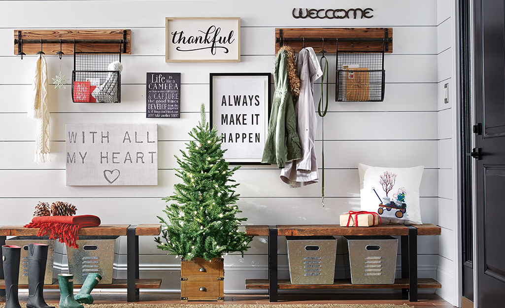 Entryway with a holiday tree and art.