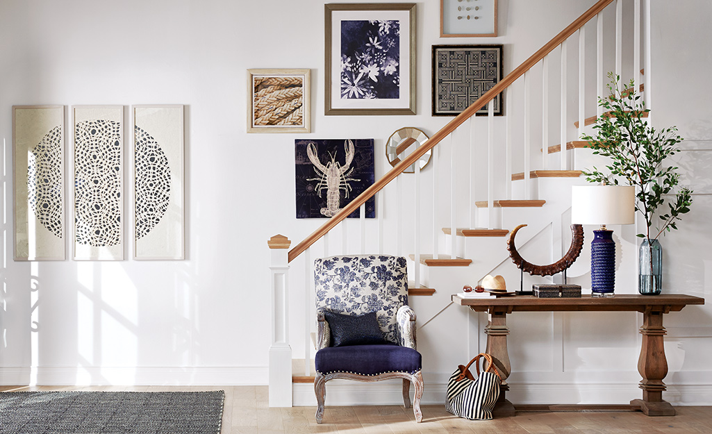 Entryway with console table in front of staircase.