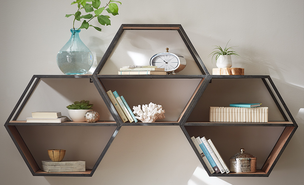 Wall shelves filled with knick-knacks and plants.
