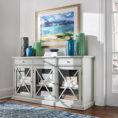 White entryway credenza with blue vases.