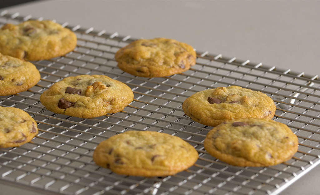 Chocolate chip cookies sitting on a cooling rack