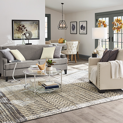 A living room decorated with wreaths and hints of fall decor.