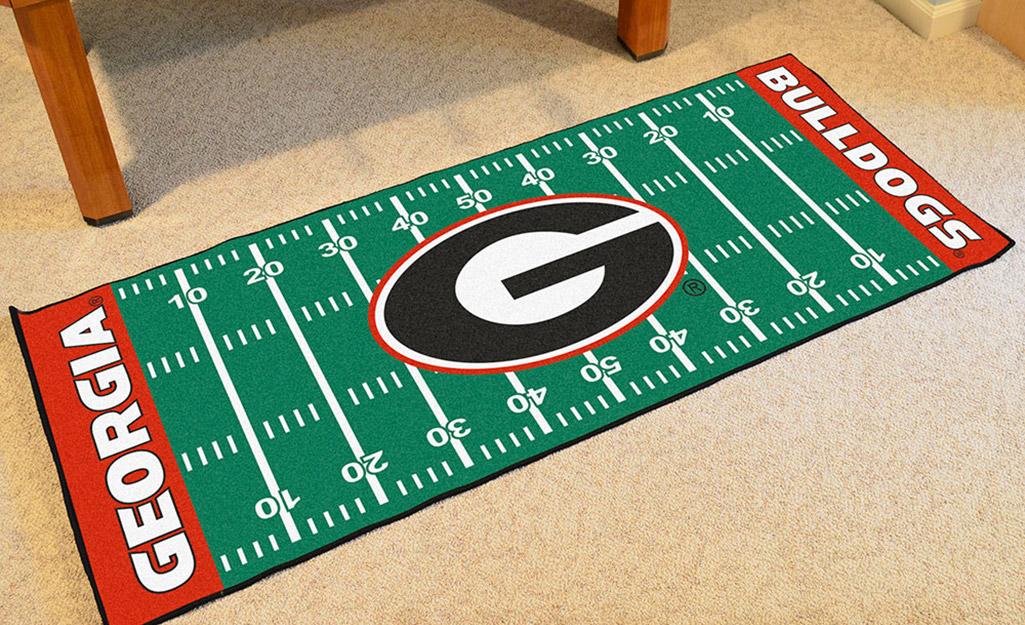 A rug with a collegiate team logo.
