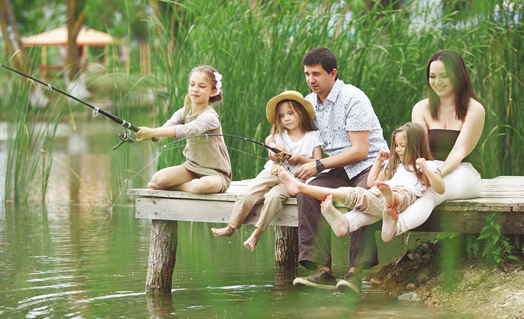 A family fishing on a dock.