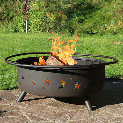 Firewood burning in a metal fire pit.