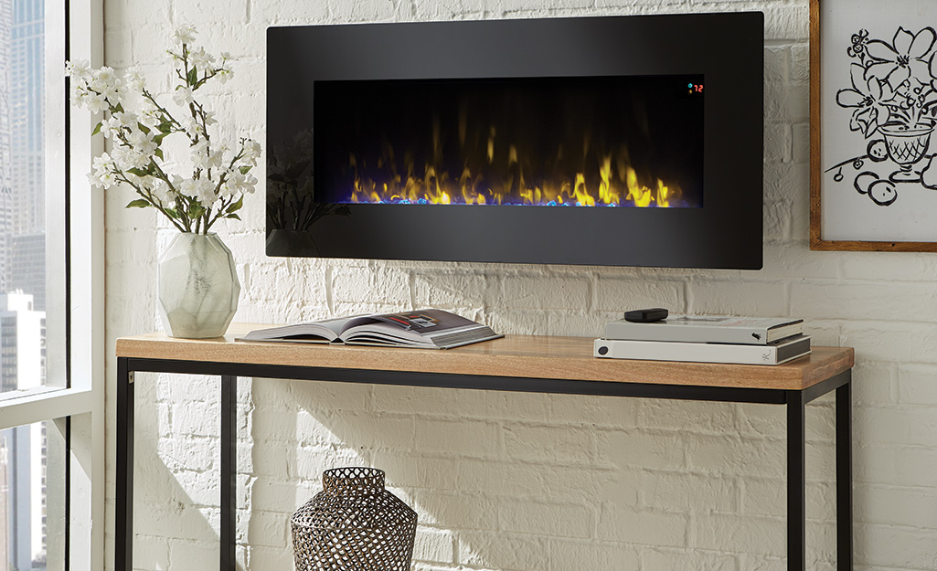 A wall-mounted fireplace in a living room.