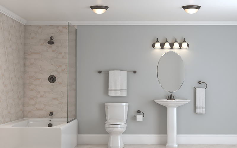 a bathroom featuring flush-mount vanity lighting