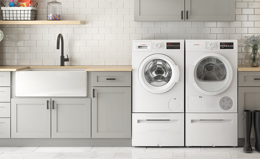 Front load washer and dryer in a laundry room.