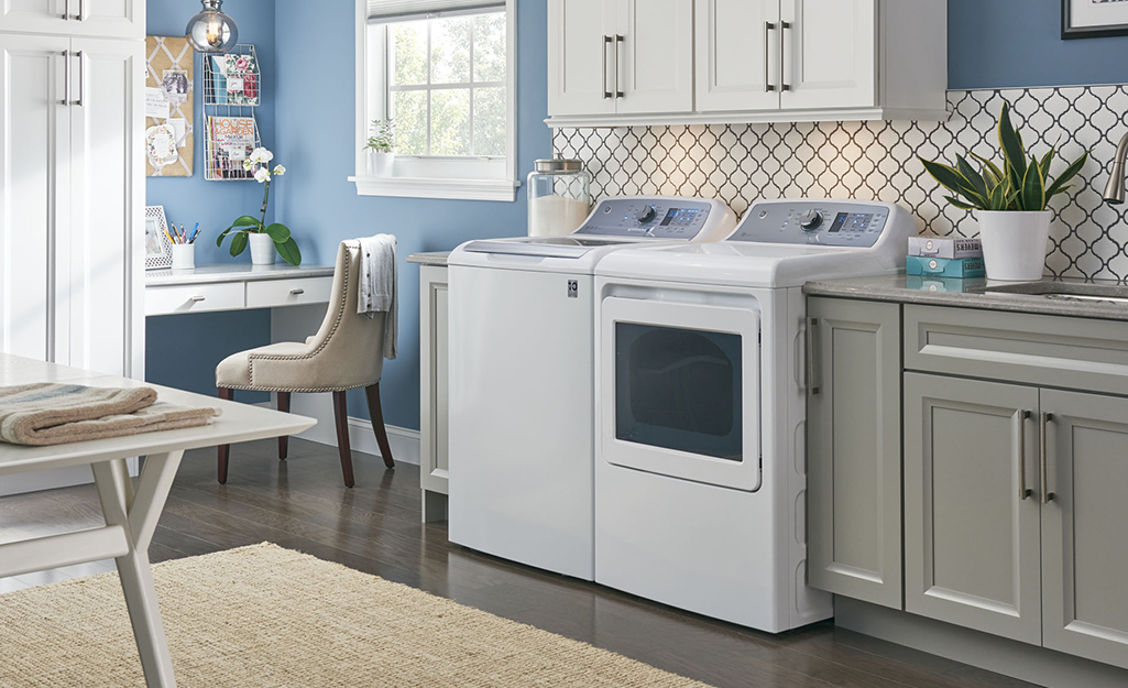 Top load washer in a kitchen.