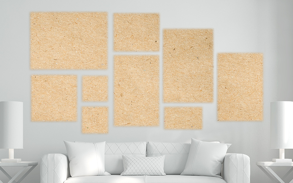 Paper squares on a wall in the shape of a gallery art wall layout.