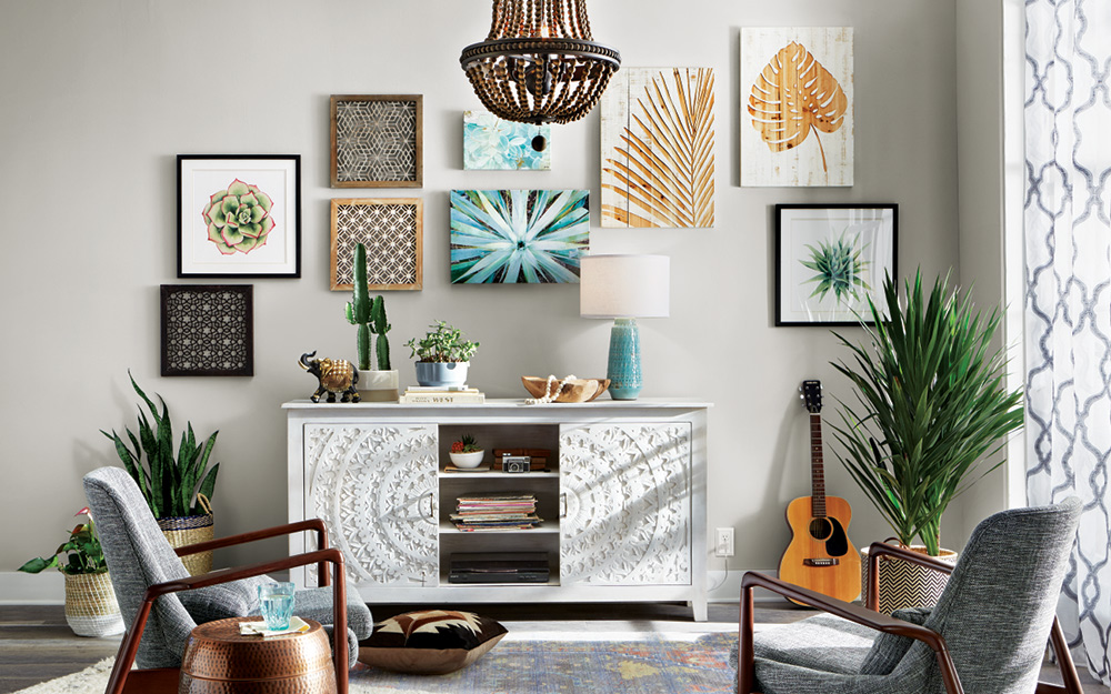 Plant-inspired gallery wall over a white buffet.