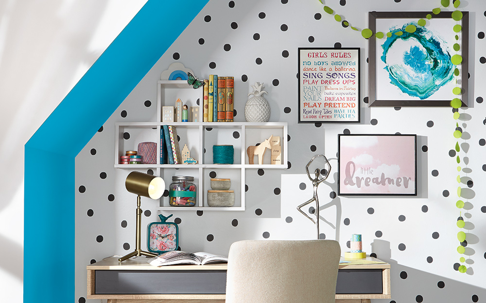Hanging shelves and wall art in a polka-dot nook.
