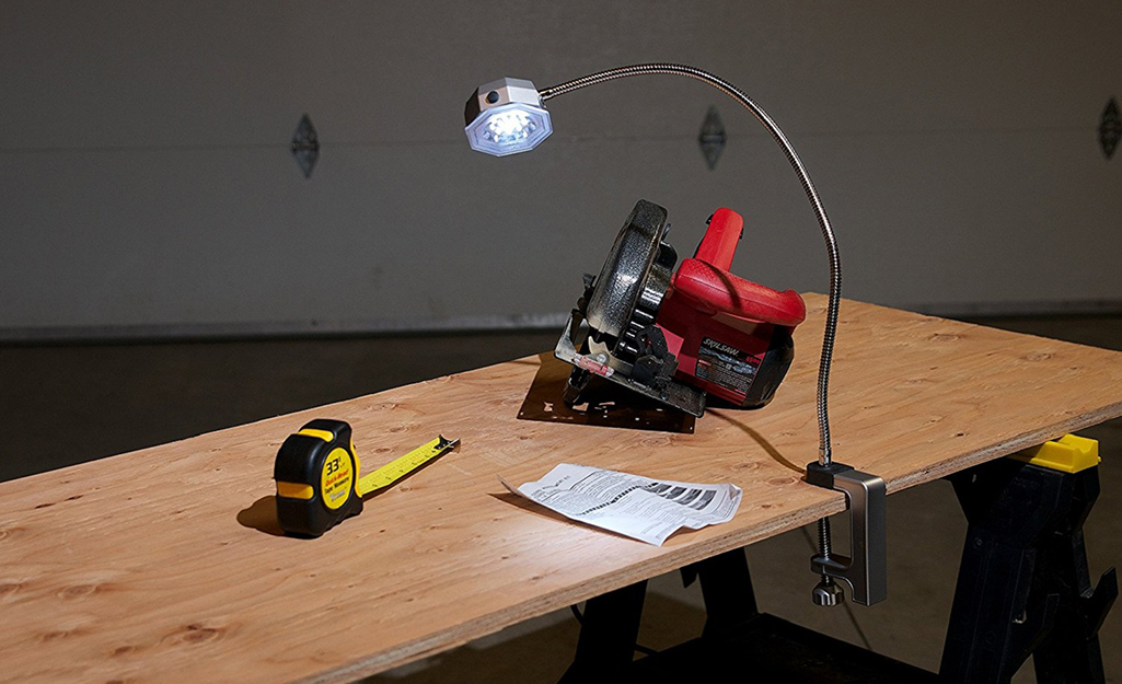 A work bench provides a surface for a tape measure and a circular saw.