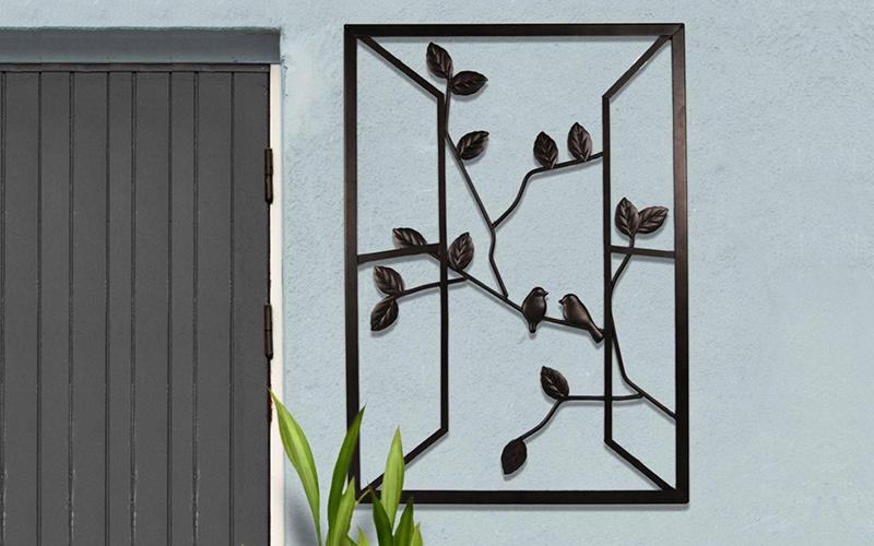 A piece of metal outdoor wall art.