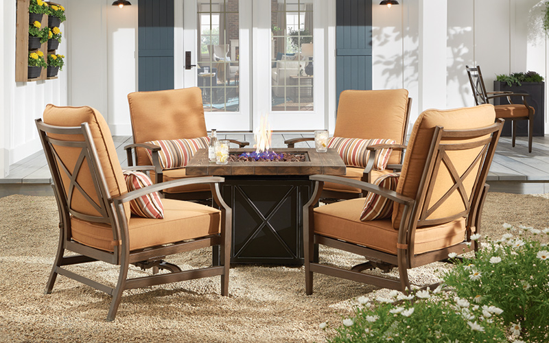 Farmhouse-style patio dining furniture in an outdoor setting.