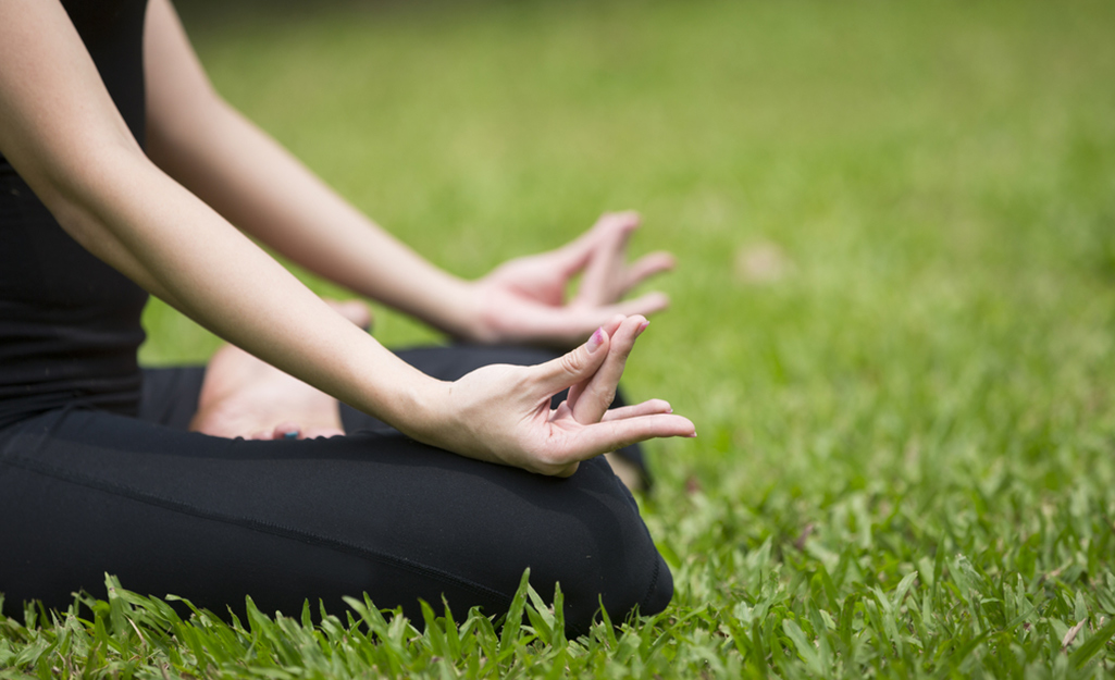 Yoga pose on a green lawn