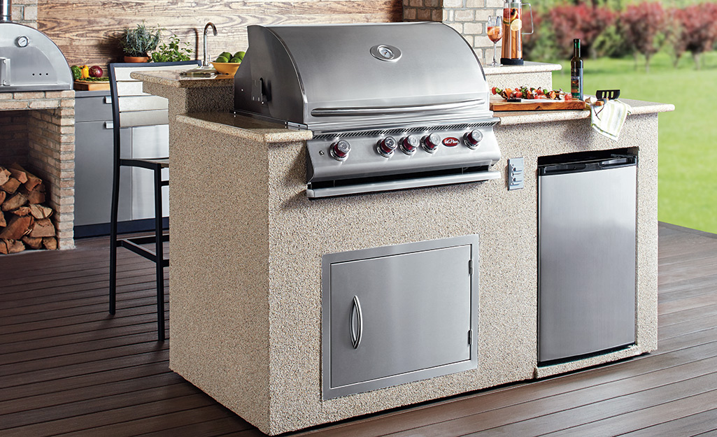 A built-in gas grill is part of an outdoor kitchen.
